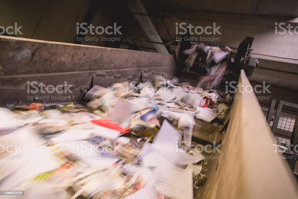 Trash on a conveyor belt stock photo