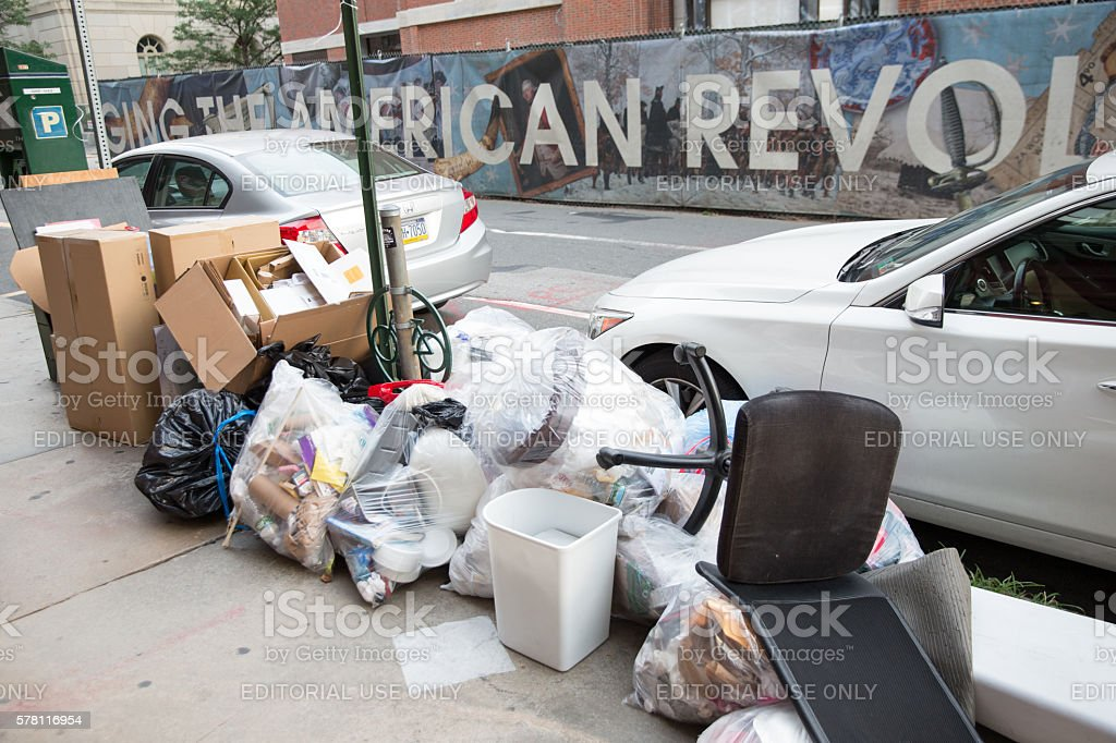 Trash on sidewalk in Phuladelphia stock photo