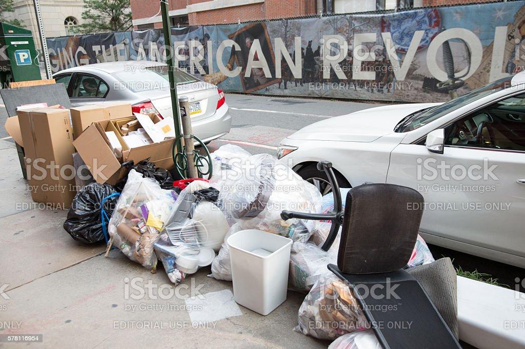 Trash on sidewalk in Phuladelphia stock photo