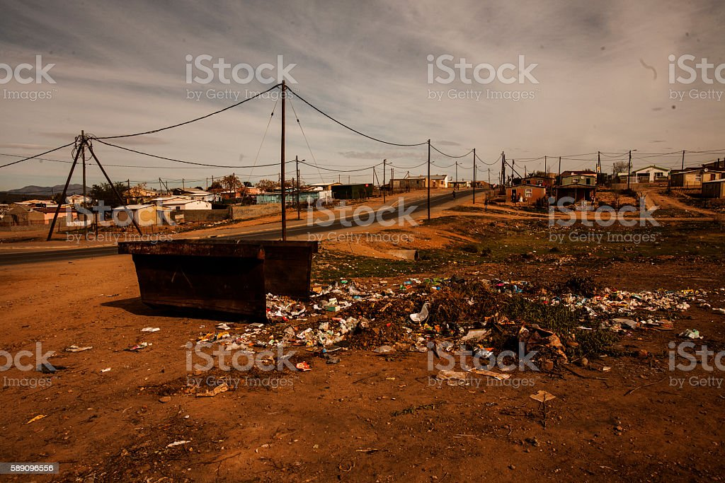 Trash piled up from a skip outside ghetto stock photo