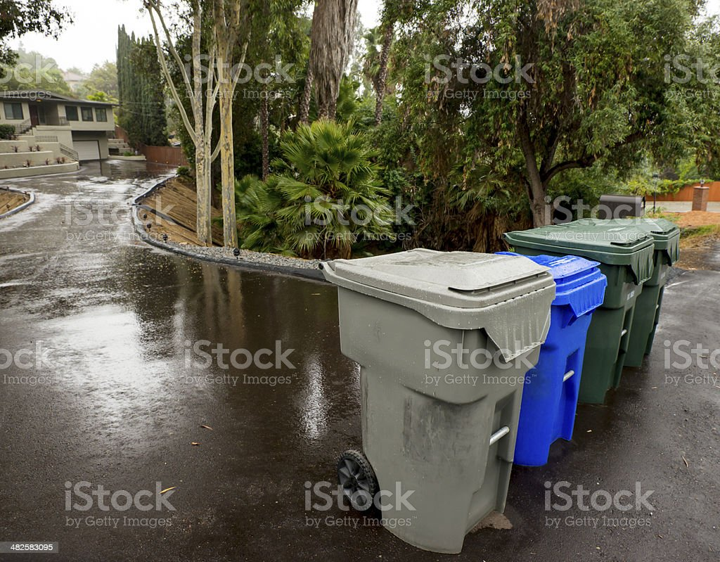 Trash, Recycling and Green Leaf Bins on the Street stock photo