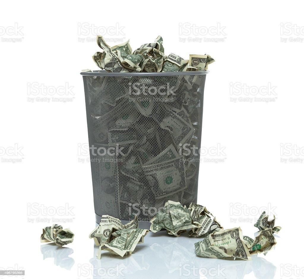Trashcan full of money stock photo