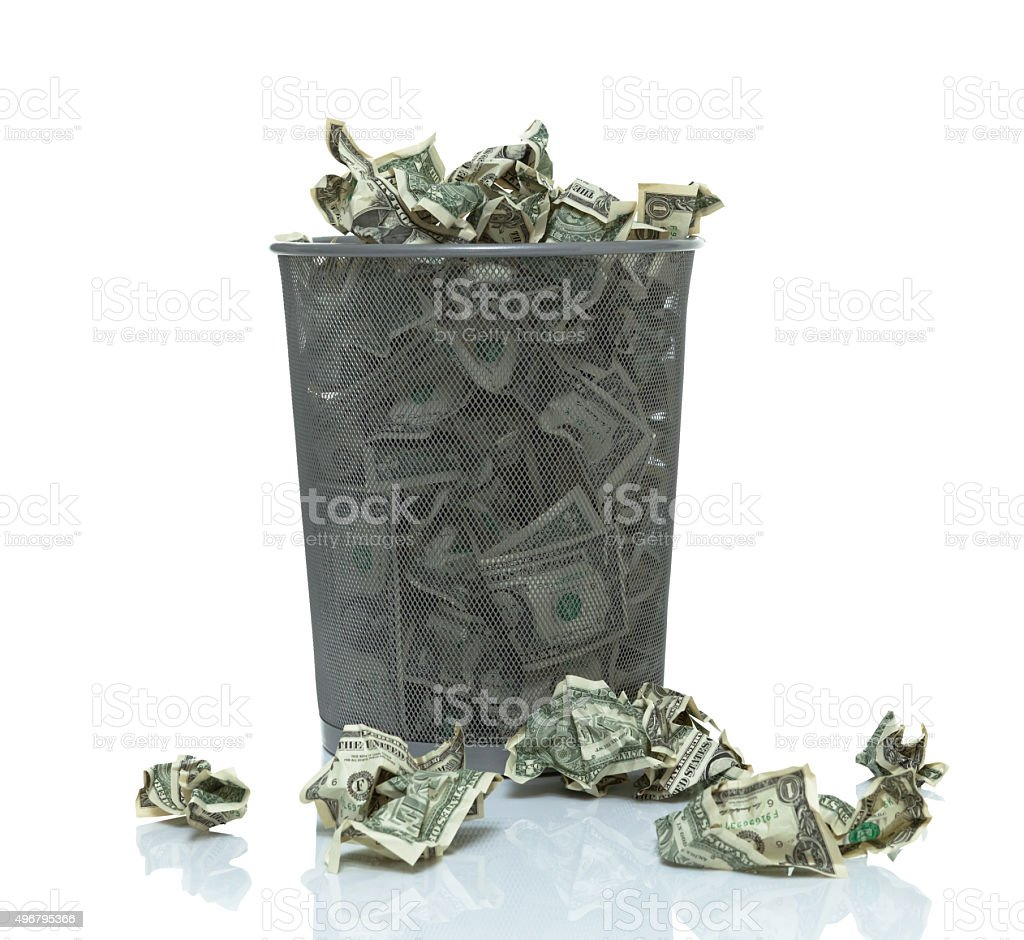 Trashcan full of money stock photo
