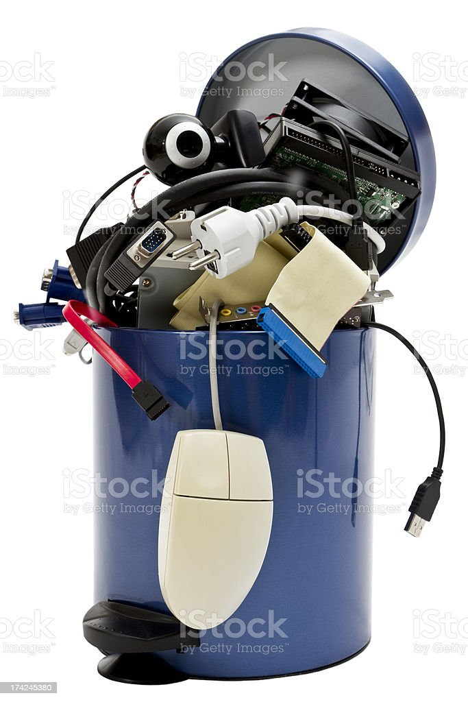 Trash-can overflowing with waste electronic appliances stock photo