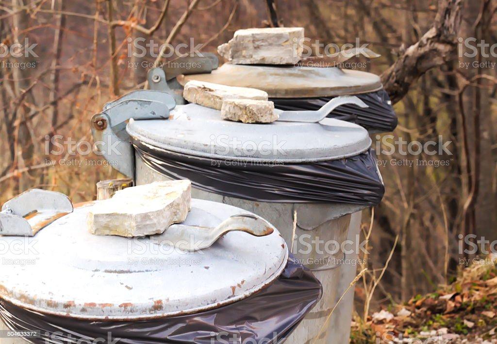 Trashes belongs into garbage bins stock photo