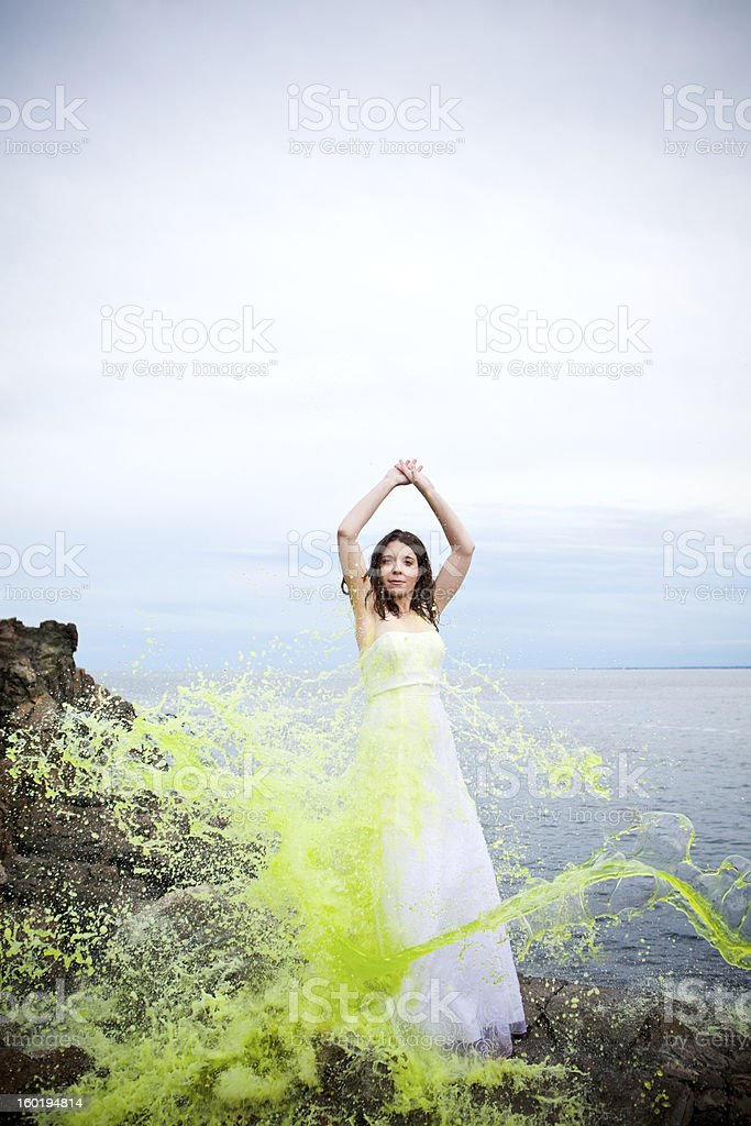 Trash-the-wedding dress with green paint stock photo