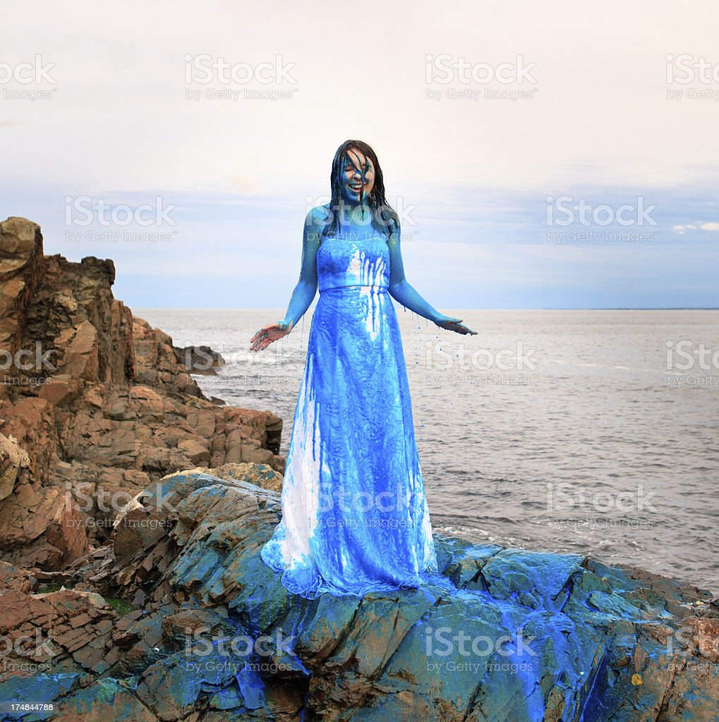 Trash-the-wedding-dress with blue paint royalty-free stock photo