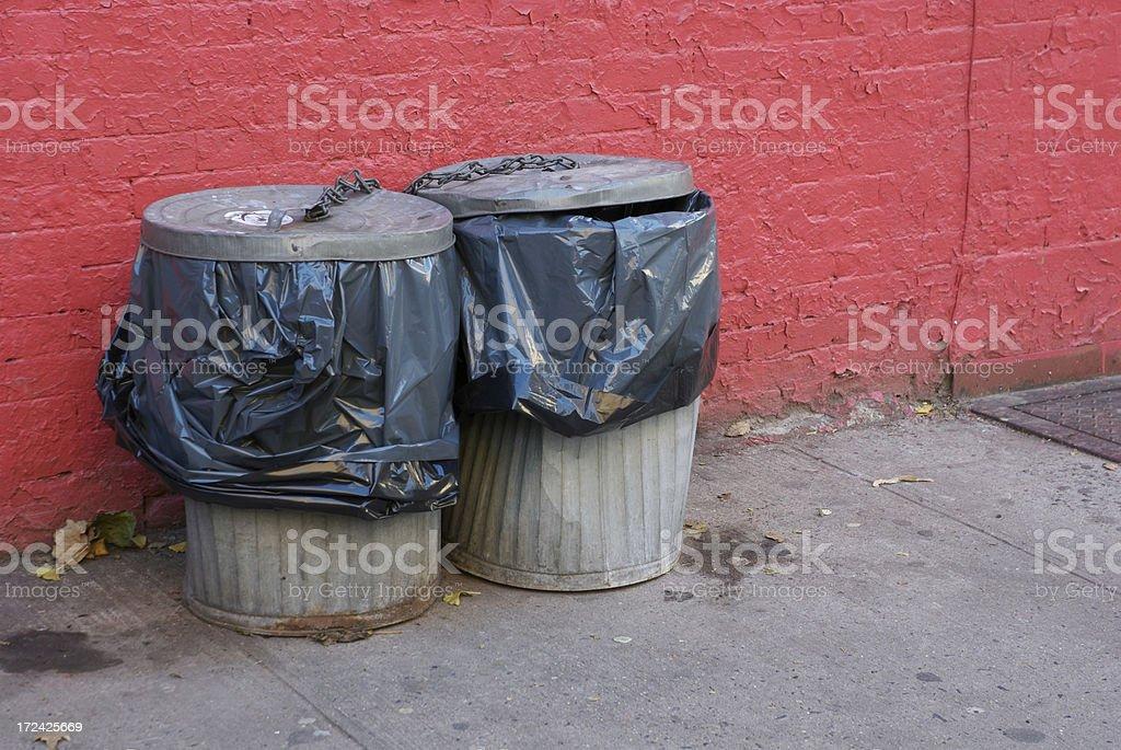 Trashy Romance Garbage Cans Pink Wall City Sidewalk royalty-free stock photo