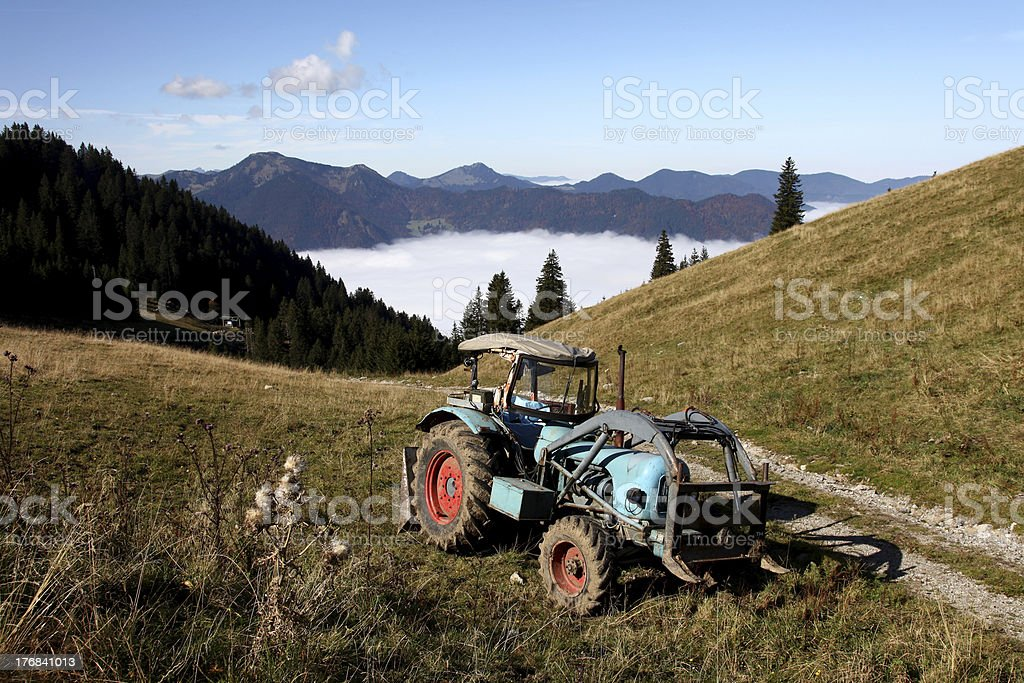 Tratcor in panoramic mountain view. stock photo