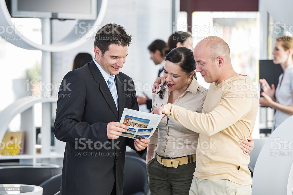 Travel Agent With Customers stock photo