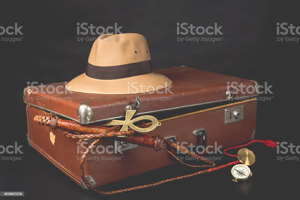 Travel and adventure concept with hat, suitcase stock photo