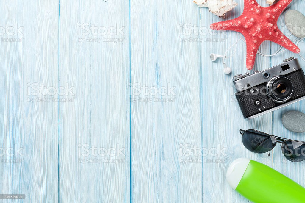 Travel and vacation background with items over wood stock photo