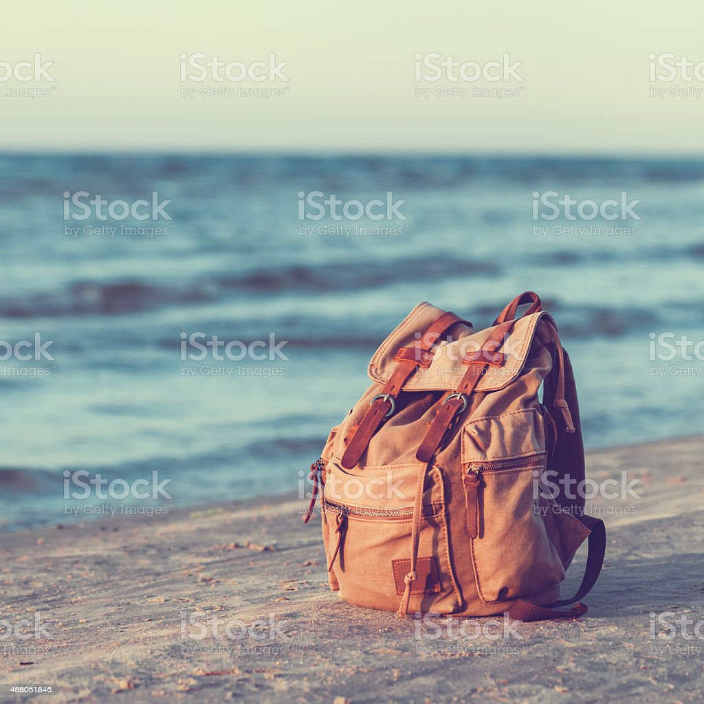 Travel Backpack on  Sea Beach. stock photo