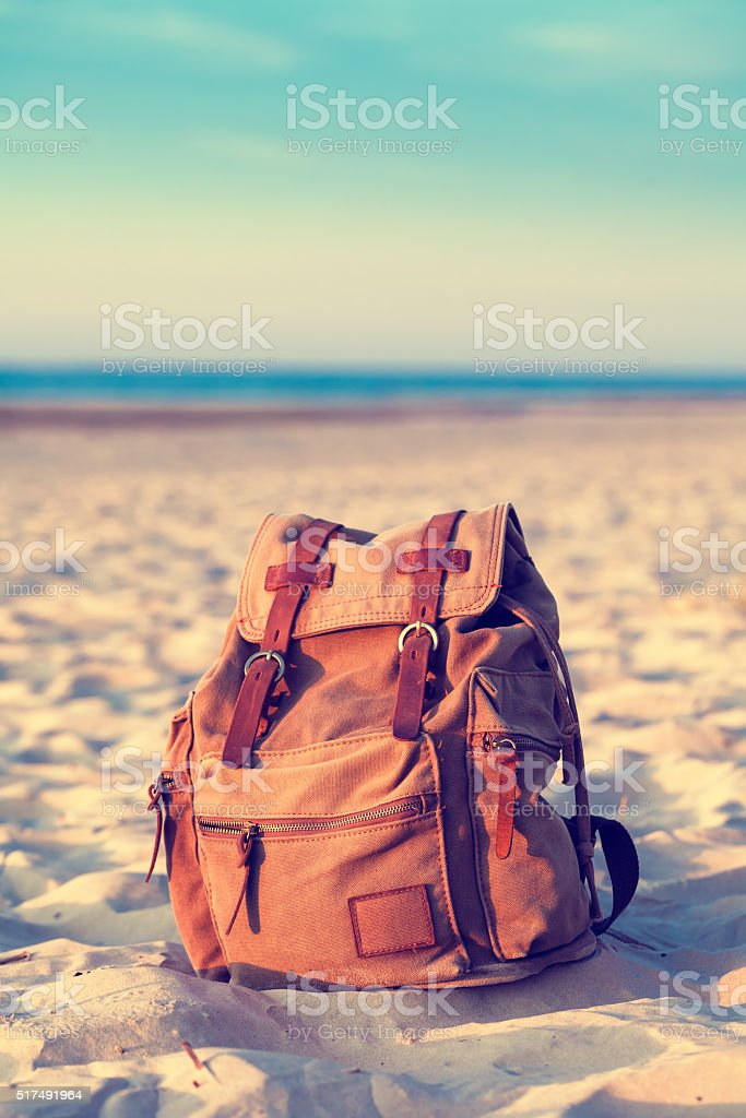 Travel Backpack on Summer Sea Beach. stock photo