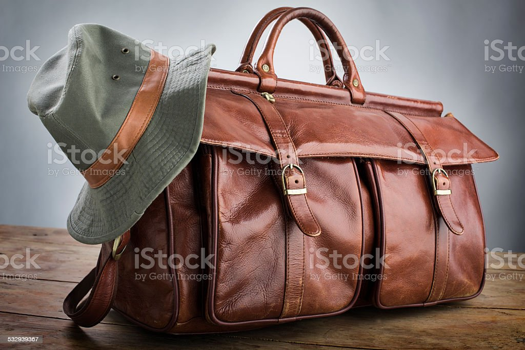 Travel bag with hat stock photo