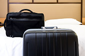 Travel bags in a hotel room