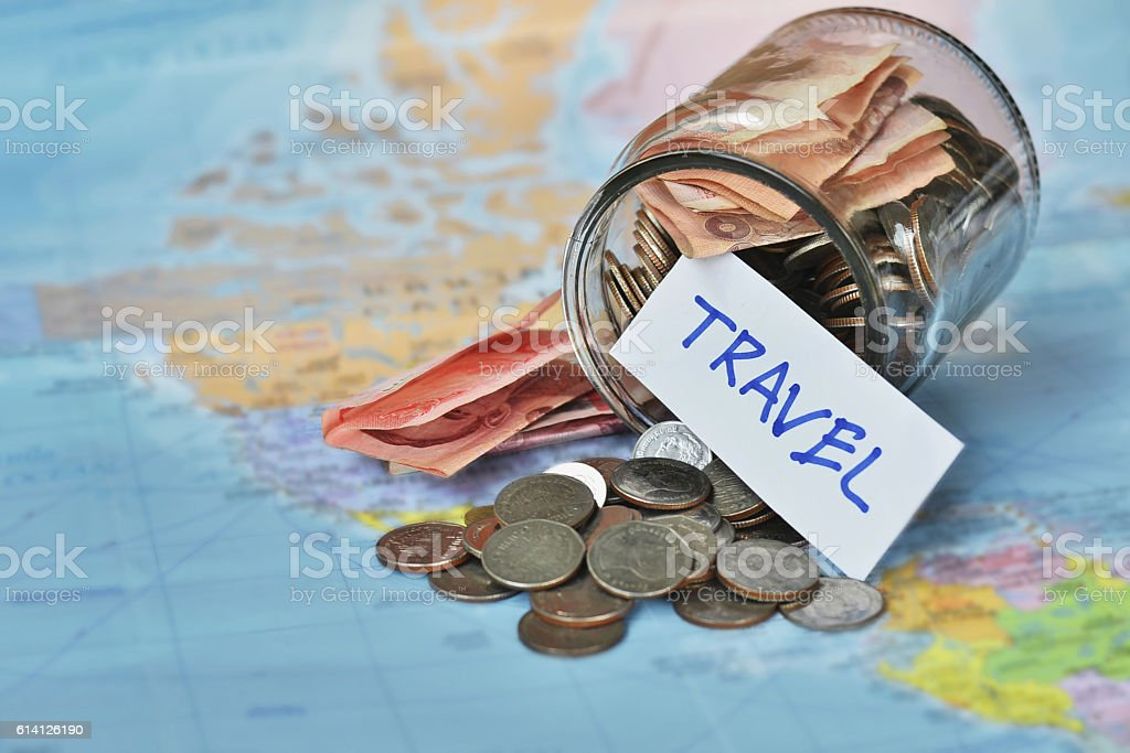 Travel budget - vacation money savings in a glass jar stock photo