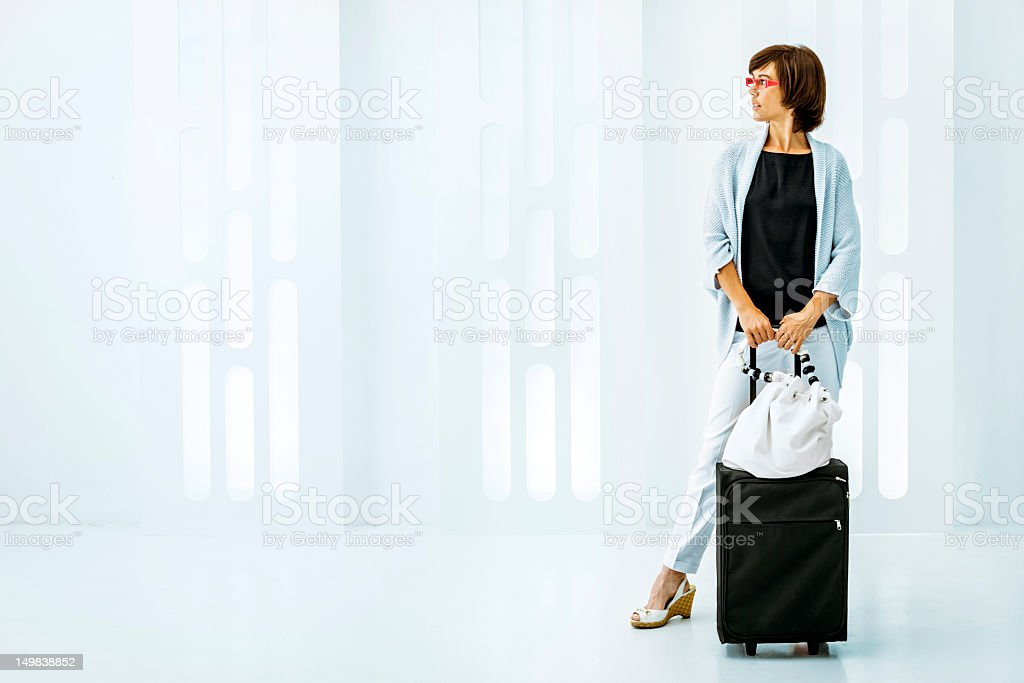 Travel: business woman with trolley royalty-free stock photo