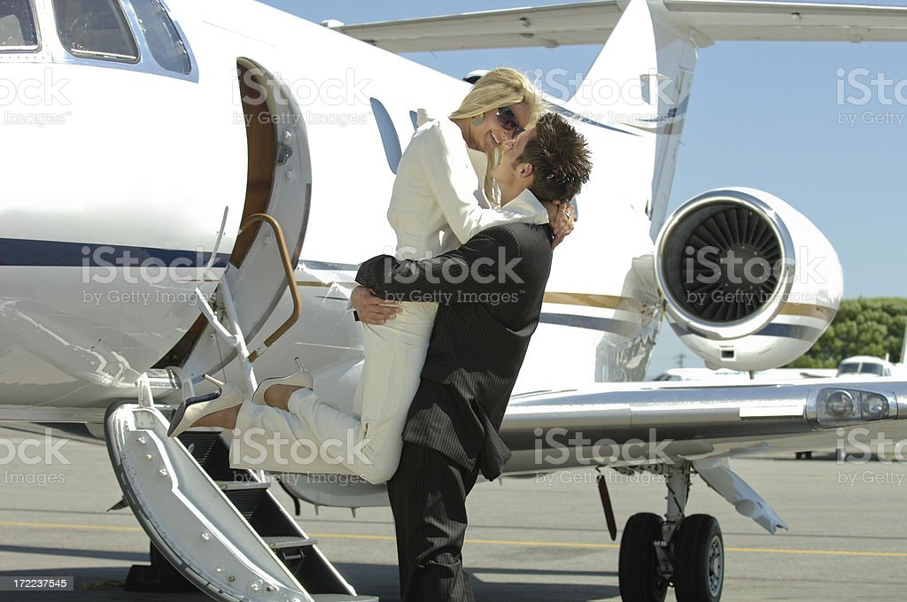 Travel - Businessman and woman by a private jet. royalty-free stock photo