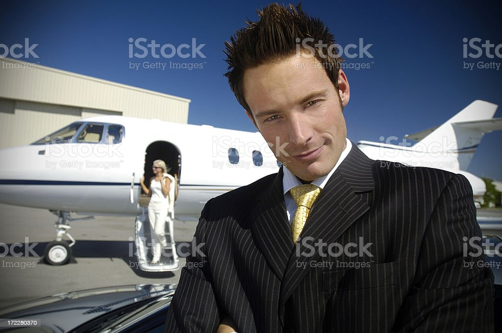 Travel - Businessman and woman by private jet royalty-free stock photo
