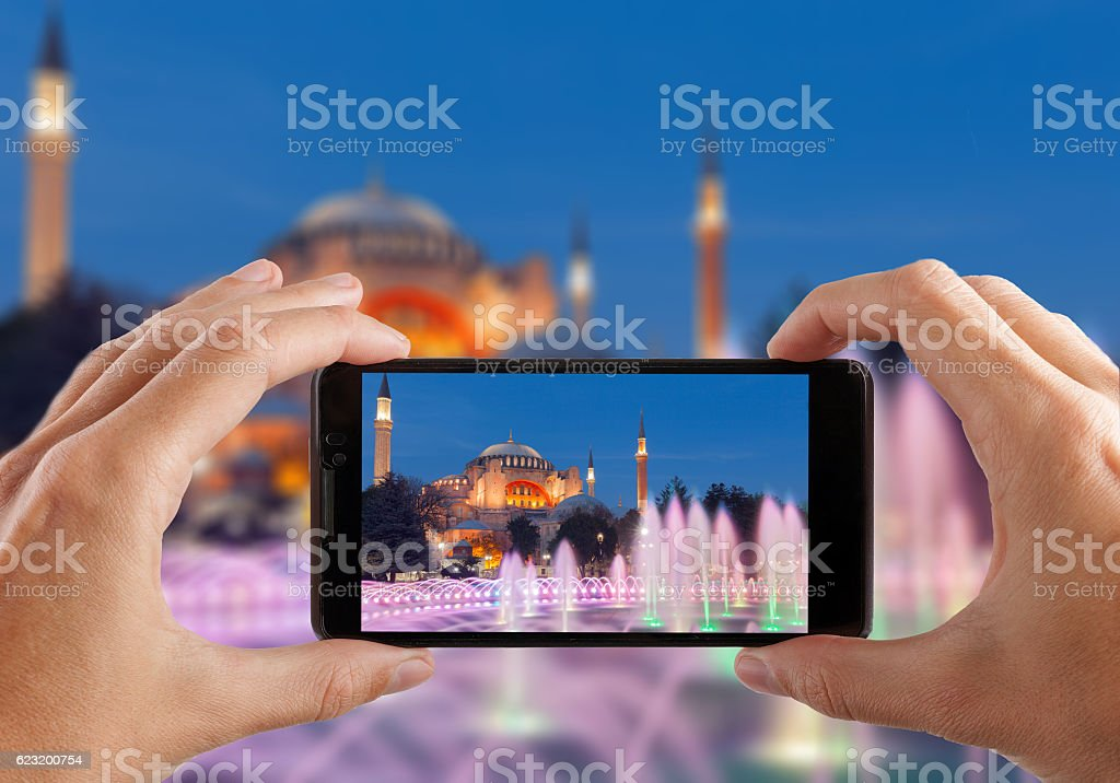 Travel concept. Hands making photo of night city with smartphone stock photo