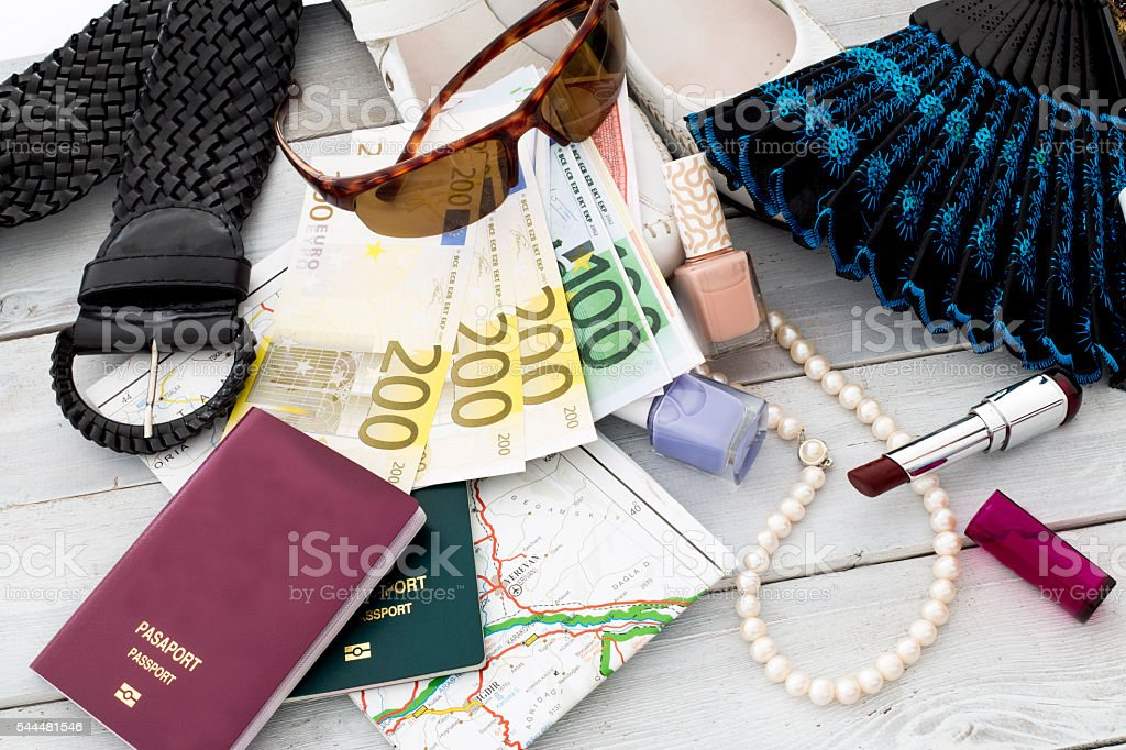 Travel concept. Woman accessories, straw hat, passport and money stock photo