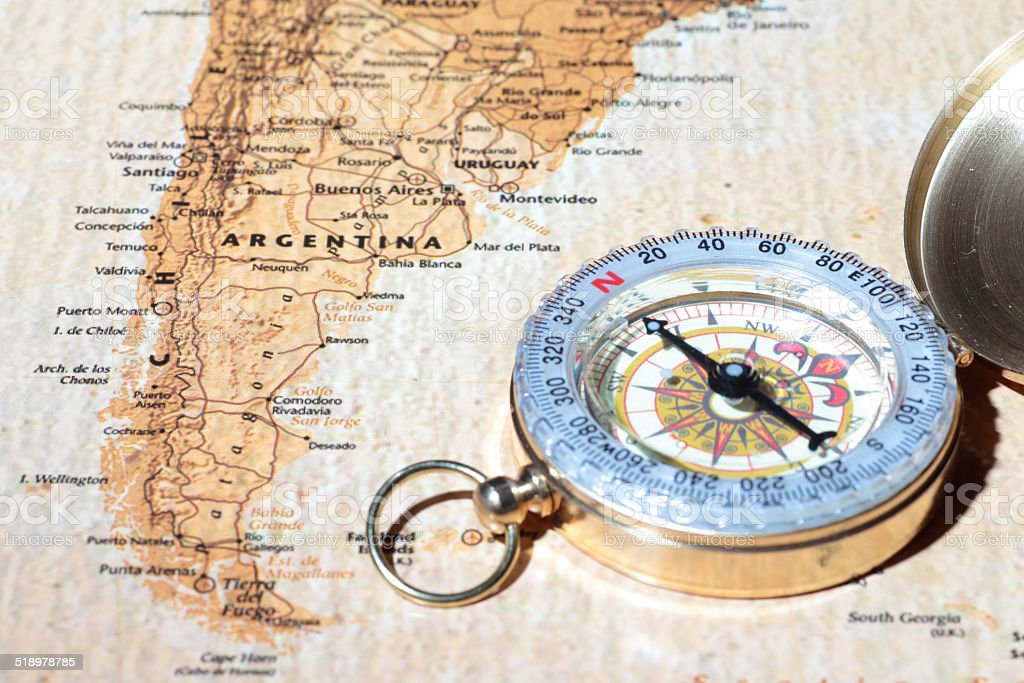 Travel destination Argentina, ancient map with vintage compass stock photo