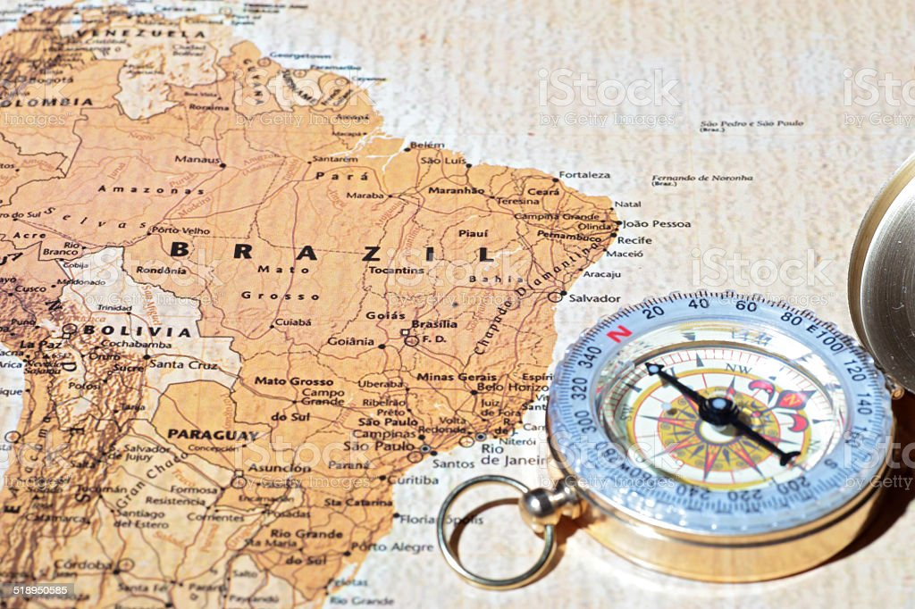 Travel destination Brazil, ancient map with vintage compass stock photo