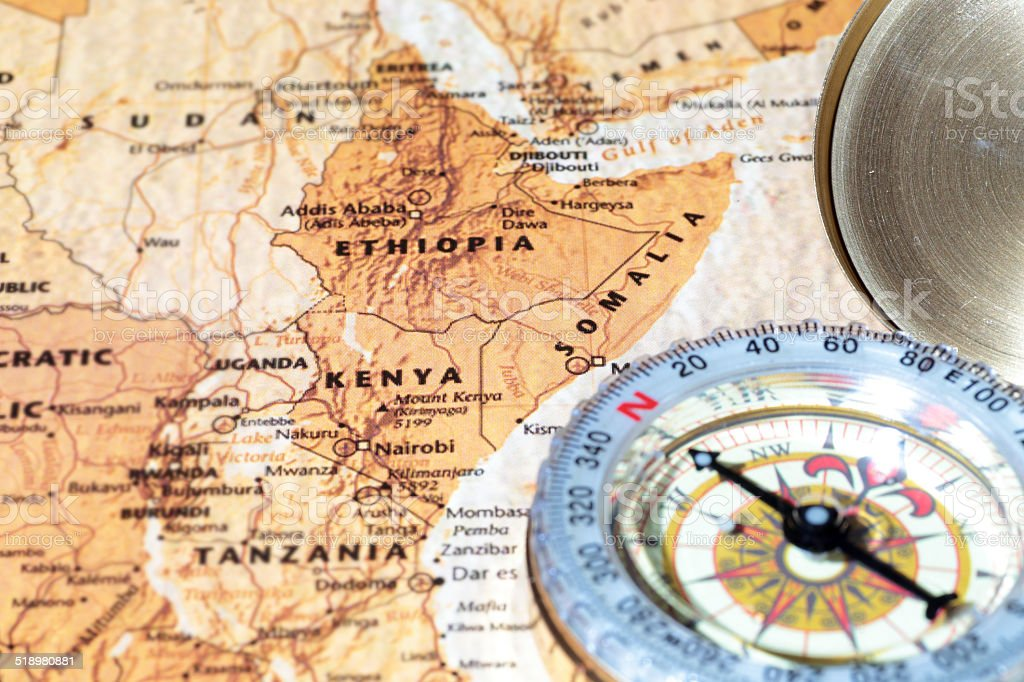 Travel destination Kenya, Ethiopia, Somalia: ancient map with vintage compass stock photo