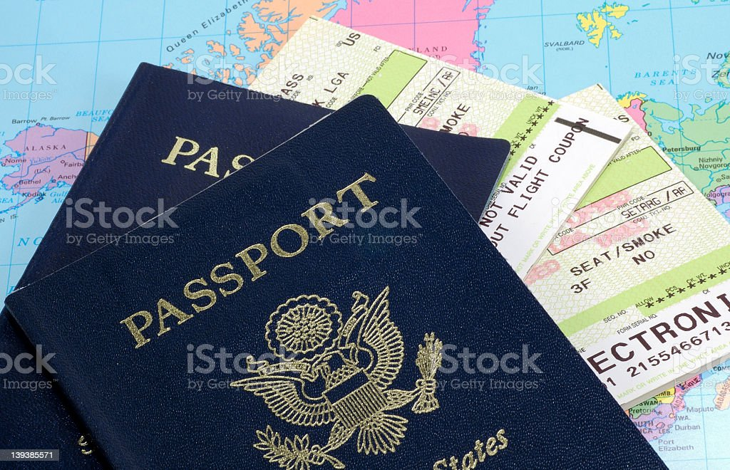 Travel documents and a passport with tickets stock photo