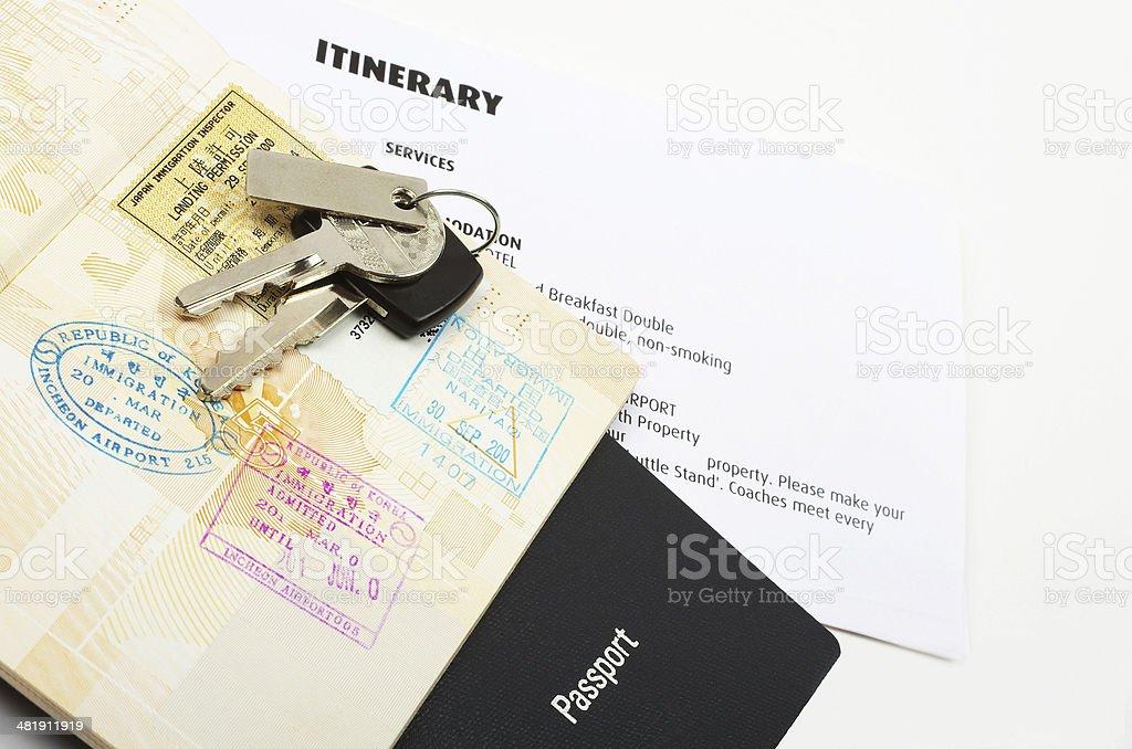 travel documents and keys stock photo