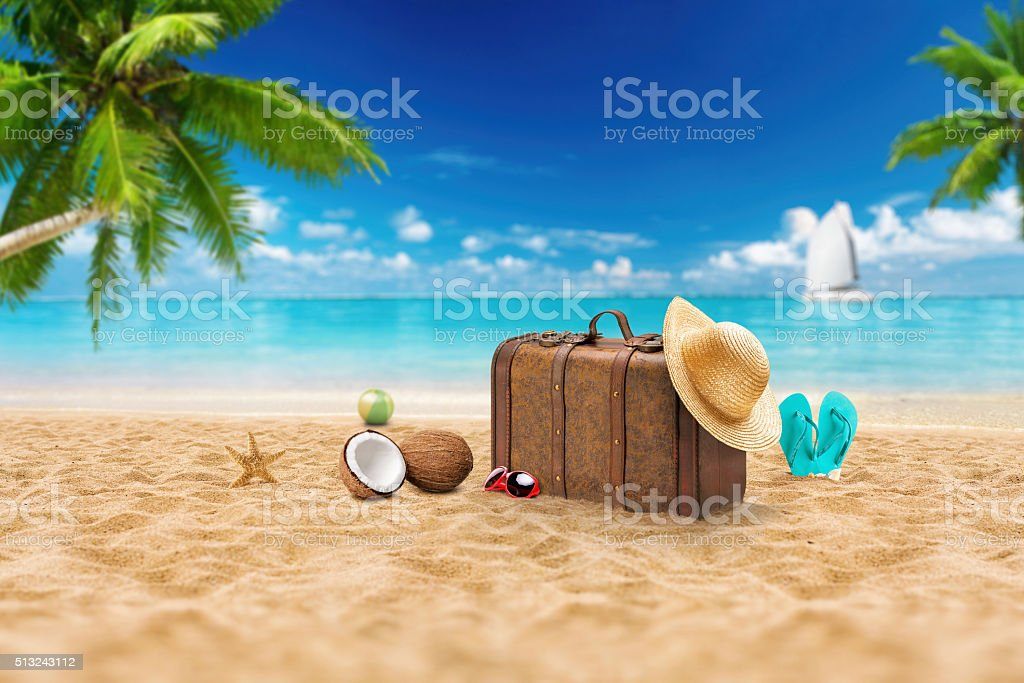 Travel holiday vacation suitcase with sunglasses.  Advertisement on travel suitcase stock photo