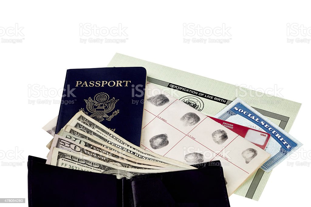 Travel Identification Papers with US Currency stock photo