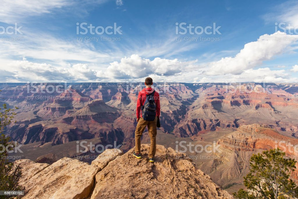 Travel in Grand Canyon, man Hiker with backpack enjoying view stock photo