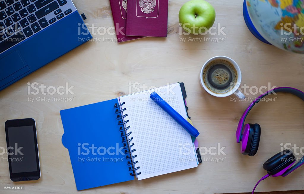 Travel items, notebook, pen, pc, globe, coffee on wooden background stock photo