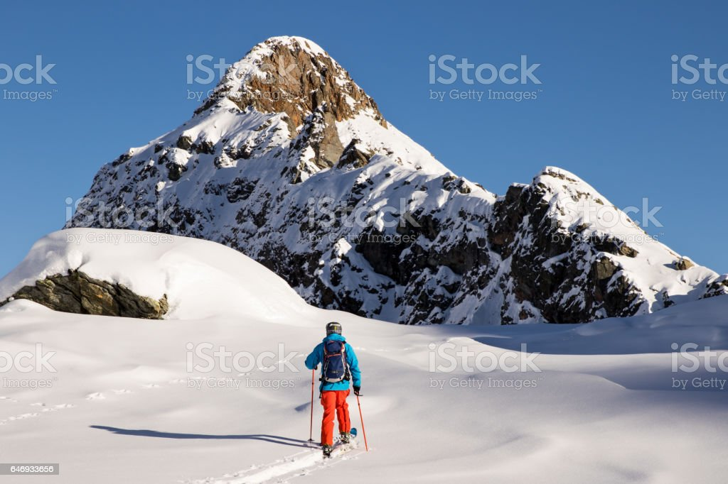 Travel Like a Local - Free skier on a back country tour in the Italian Alps stock photo