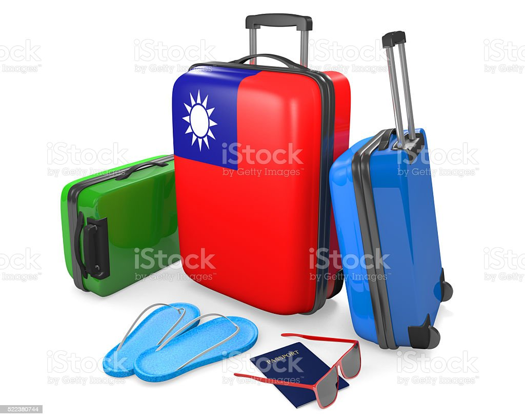 Travel luggage items and accessories for a vacation to Taiwan stock photo
