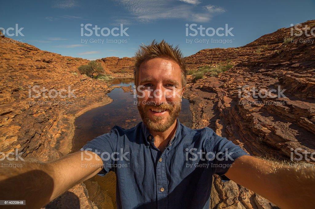 Travel man hiking takes selfie portrait stock photo