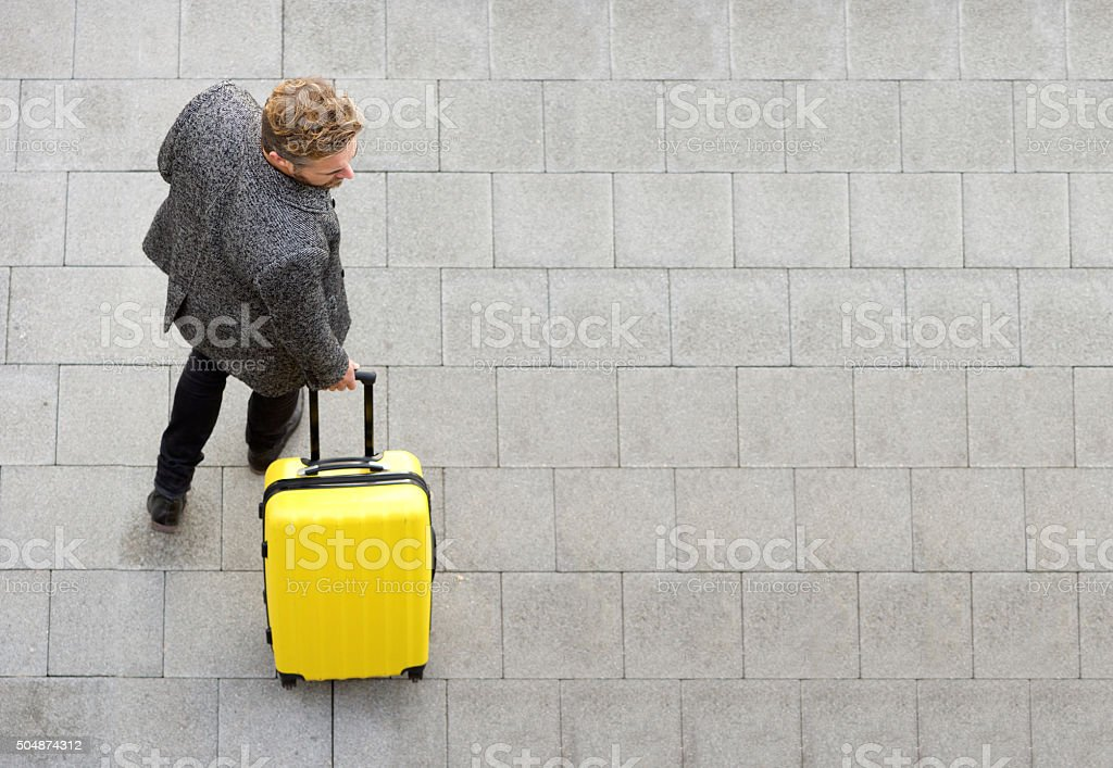 Travel man walking with suitcase stock photo