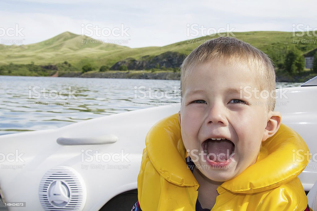 Travel of children on water in the boat royalty-free stock photo