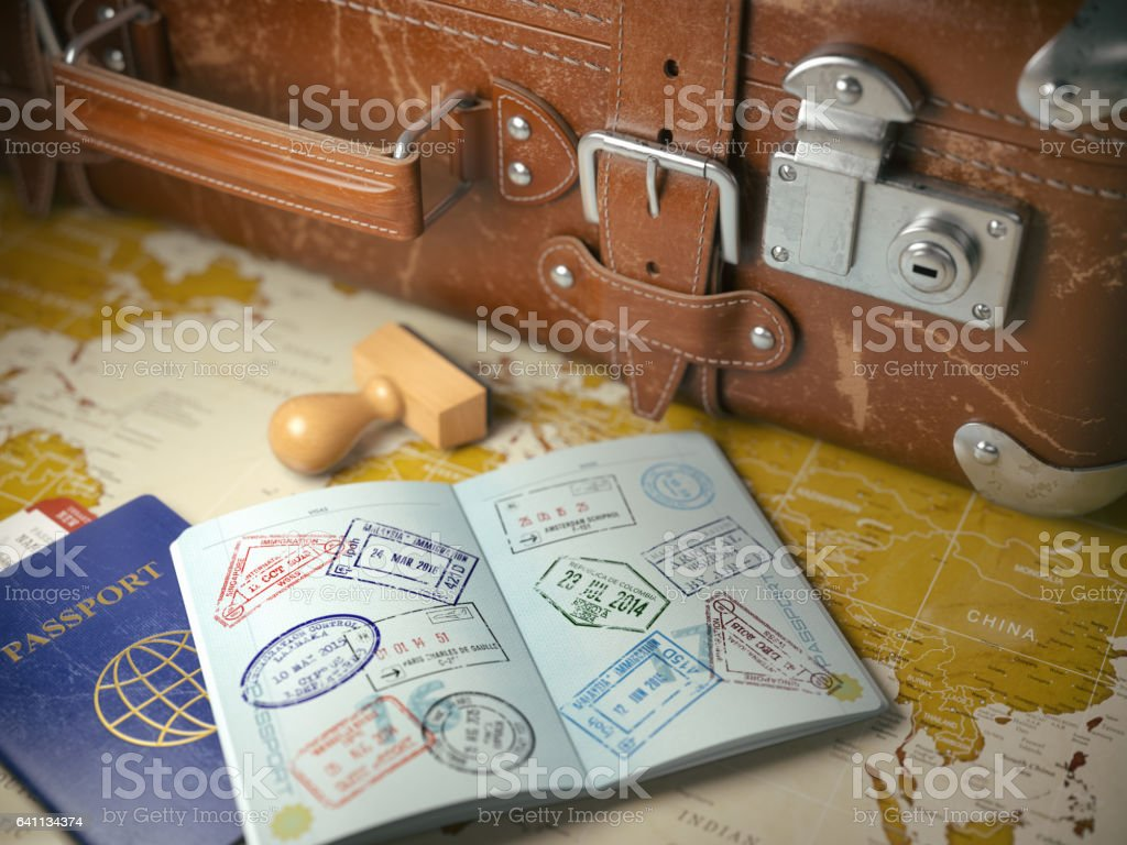 Travel or turism concept.  Old  suitcase  with opened passport stock photo