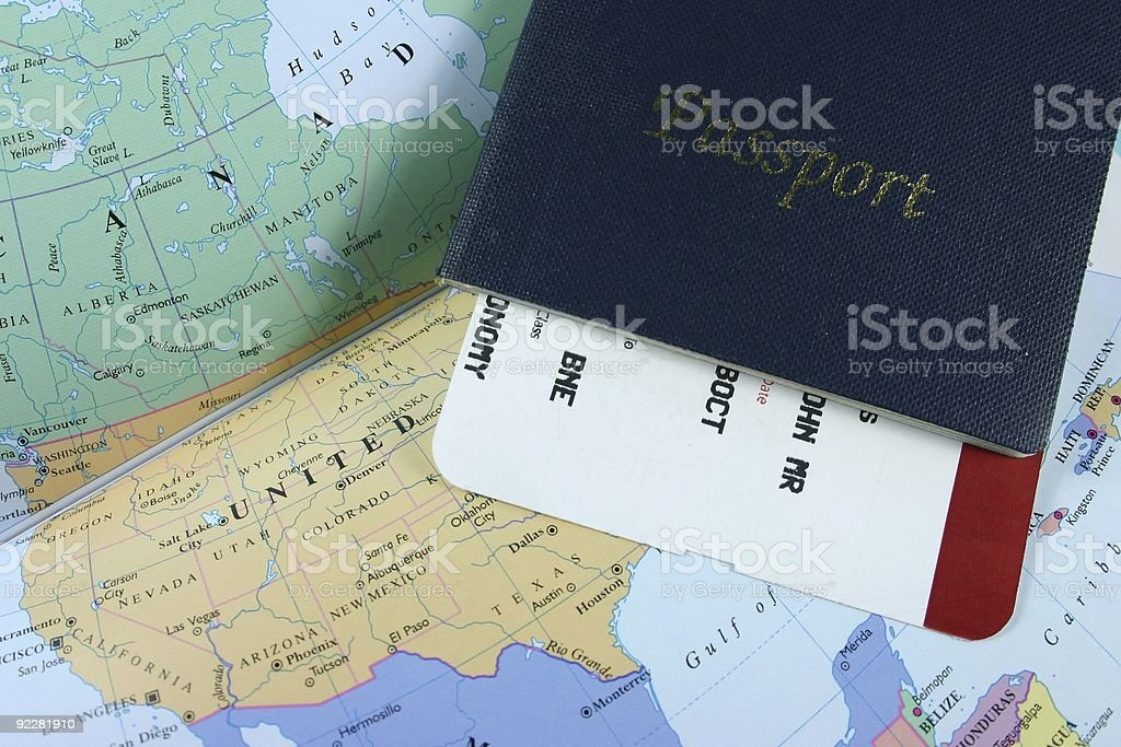 A travel passport laying on a world map royalty-free stock photo