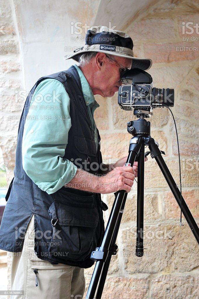 Travel photographer at work stock photo
