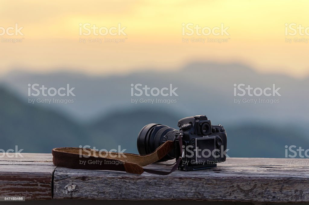Travel photographer equipment with beautiful landscape stock photo