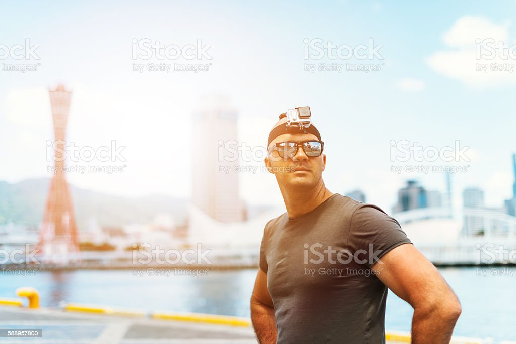 Travel photographer with action camera stock photo