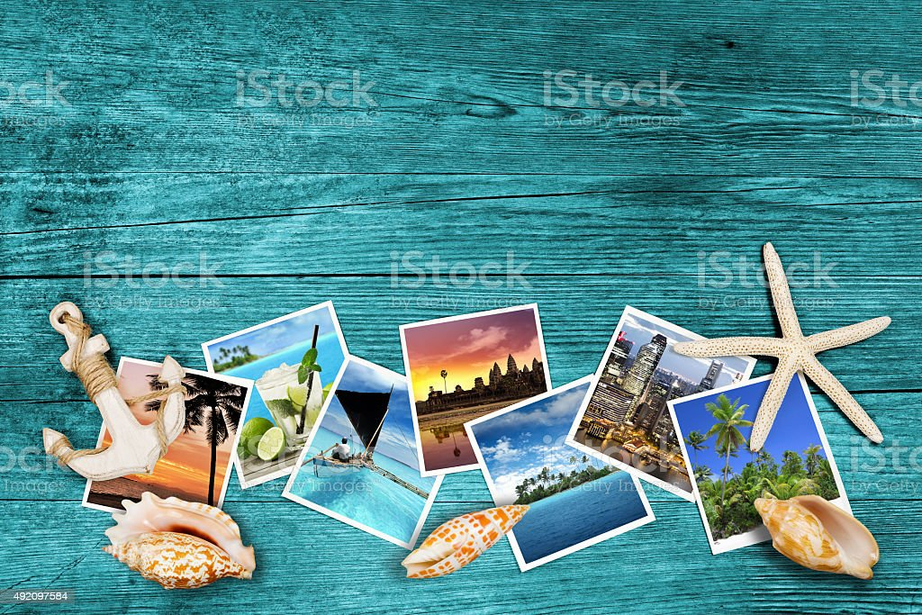 travel photos and seashells on azure wood stock photo