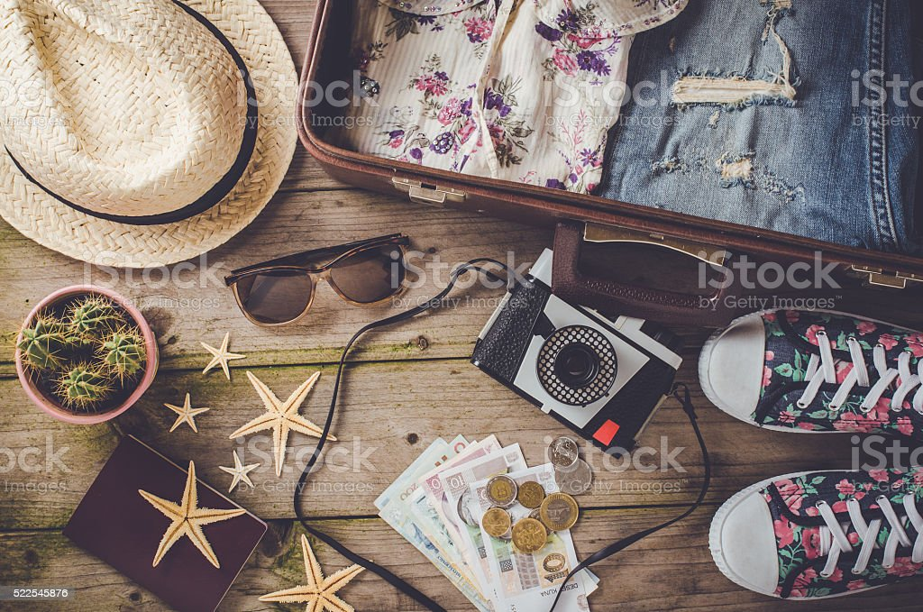 Travel preparations on wooden table stock photo