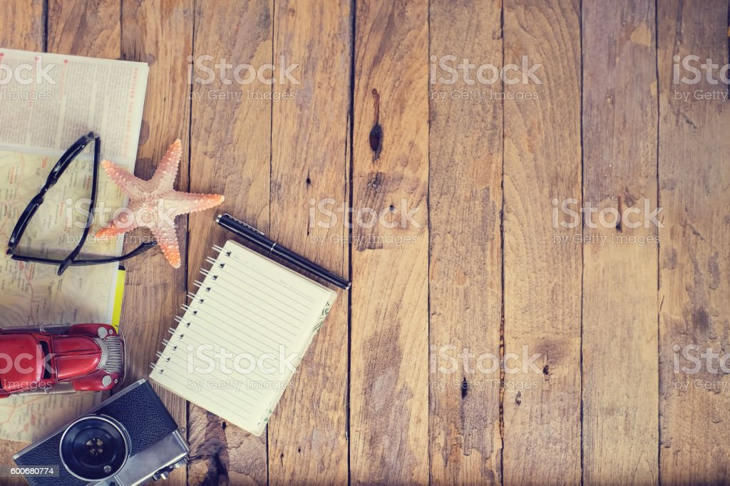 Travel stuff on wood table Concept stock photo