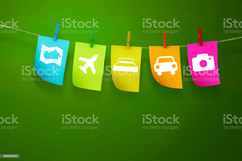 Travel symbol in Sticky notes  with light green background stock photo