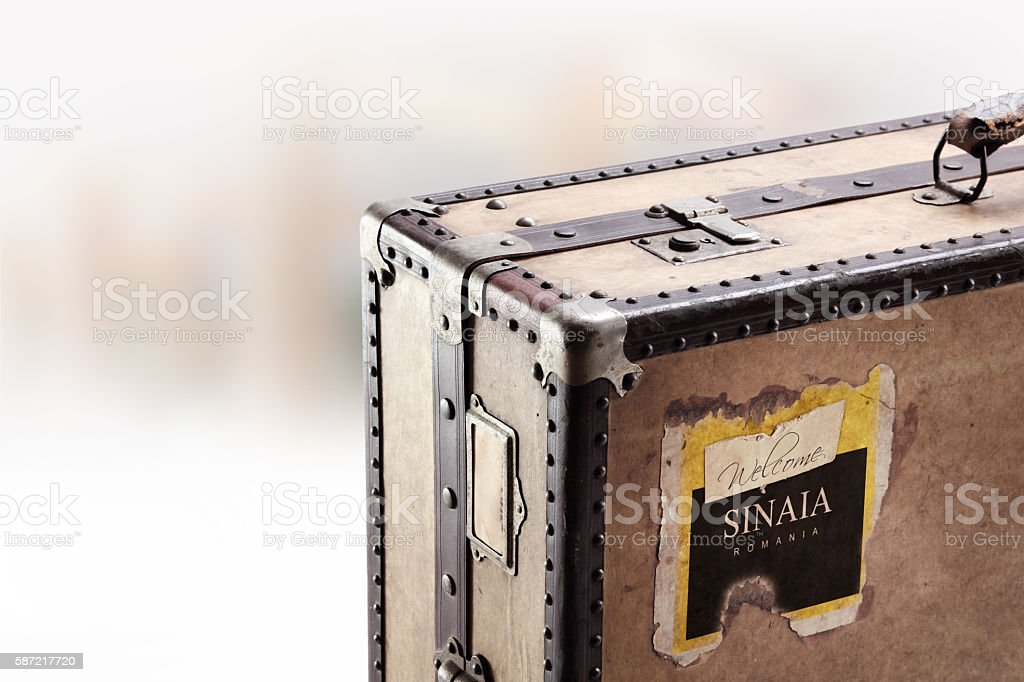 Travel to Sinaia, Romania. Old retro suitcase. stock photo